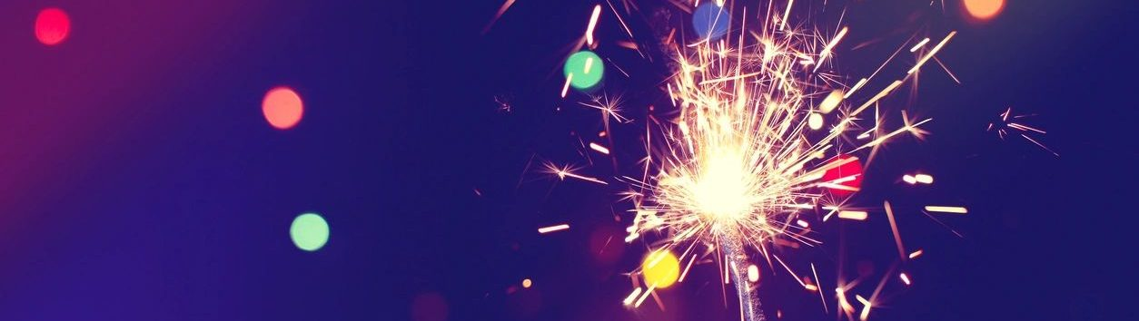 A lit sparkler. New Year. New You.